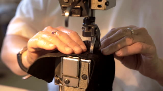 stitching together - leather stock videos and b-roll footage