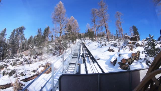 st.moritz swiss snow switzerland winter vacation talstation point of view. - tram point of view stock videos and b-roll footage