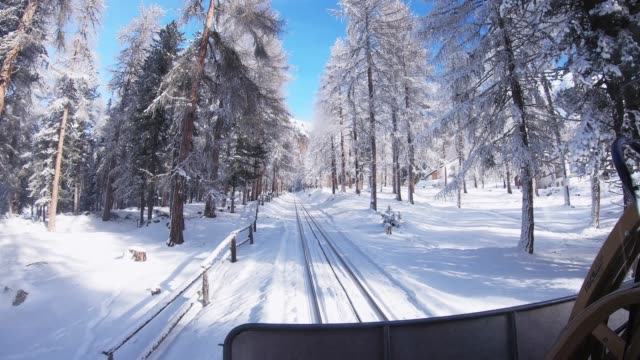 st.moritz swiss snow switzerland winter vacation tram point of view. - tram point of view stock videos and b-roll footage