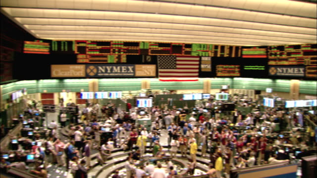 Stock brokers fill the floor at the New York Mercantile Exchange. Available in HD.