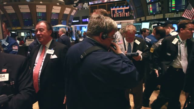 wide shot - stock brokers work on the floor of the new york stock exchange. - market trader stock videos & royalty-free footage