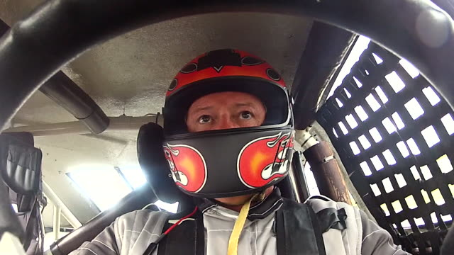 stock car driver grips and turns steering wheel in high speed race. (steering wheel pov) - sideways glance stock videos & royalty-free footage