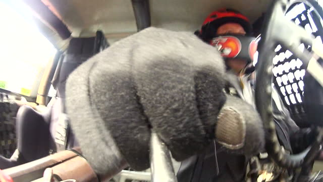 CU. Stock car driver shifts gears in cockpit. (Gear Stick POV)