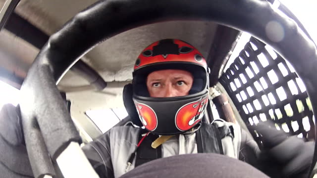 CU. Stock car driver shifts gears in cockpit. (Gear Stick POV)