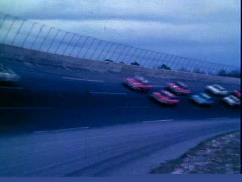 Stock cars crossing starting line judge waving green flag starting Daytona auto 500 race Daytona International Speedway / AJ Foyt racing 1963 Pontiac...