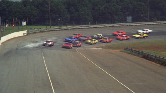 WS TD Stock cars racing around track on finish line
