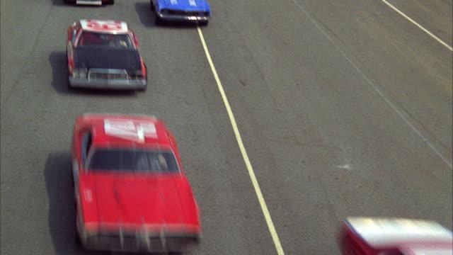 MS Stock cars racing around track on finish line