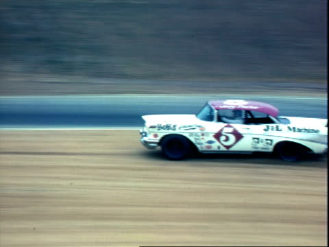 vídeos de stock, filmes e b-roll de stock cars racing in riverside 500 at riverside international raceway / mercury comet cyclone spins out into dirt scrambles to rejoin race / early... - 1960 1969