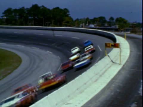 stock cars racing on bowled turn two, daytona 500, daytona international speedway / stock cars racing, approaching turn three / unidentified driver... - 1966 stock videos & royalty-free footage
