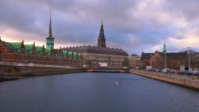 stock exchange and the danish parliament in copenhagen, denmark - parliament building stock videos & royalty-free footage
