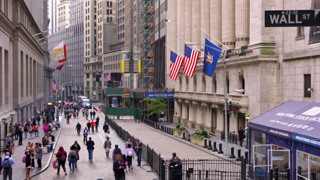 stock exchange building in wall street. businessmen walk by. - stars and stripes stock videos & royalty-free footage