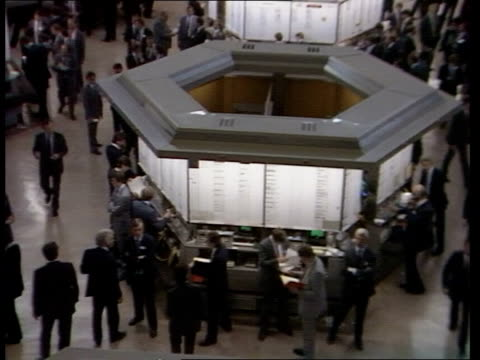 stock exchange members prepare to vote on a series of changes england london stock exchange legs of woman tilt up turns and walks across floor... - city von london stock-videos und b-roll-filmmaterial