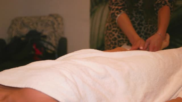 stock footage of a massage on the day beauty salons can resume body treatments at taryn aesthetic at on the lane in belsize parkwith facialist taryn... - massaging stock videos & royalty-free footage