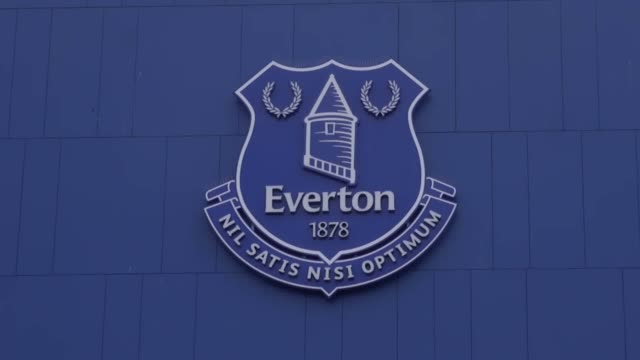 Stock footage of Goodison Park the home of Everton FC Includes shots of stands turnstiles murals club logos and billboards