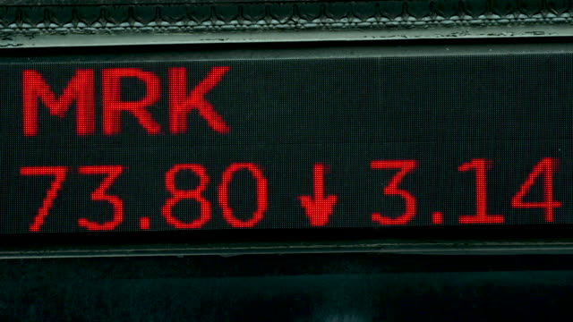 stock market data ticker tape above the entry to the new york stock exchange showing stock symbols amid the outbreak of the coronavirus disease and a... - number stock videos & royalty-free footage