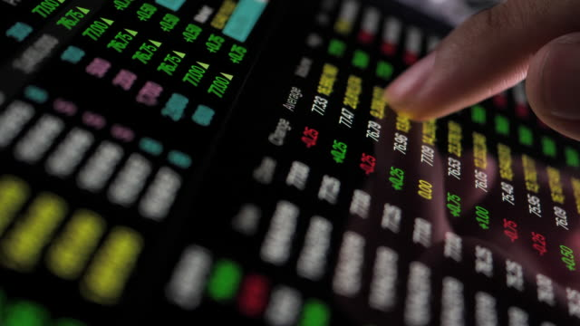 stock market data trading on digital tablet - economia video stock e b–roll