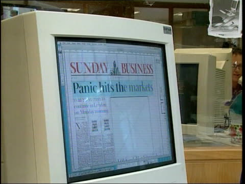 fears of crash stock market fears of crash itn england london journalist working at computer in office of sunday business putting in headline 'panic... - sonntag stock-videos und b-roll-filmmaterial
