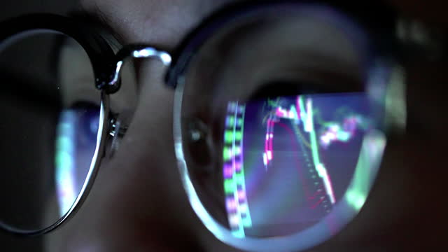 stock market graph reflection on eyeglasses - stock market stock videos & royalty-free footage