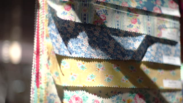 stock of multi colored fabrics with flowery printed for sewing, handmade and handicraft concept. - quilt stock videos & royalty-free footage