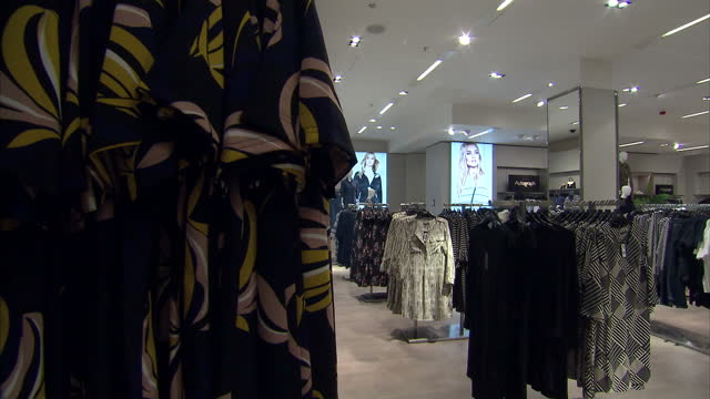 stock shots clothing on display and people browsing at marks spencer pantheon oxford street - employment issues stock videos & royalty-free footage