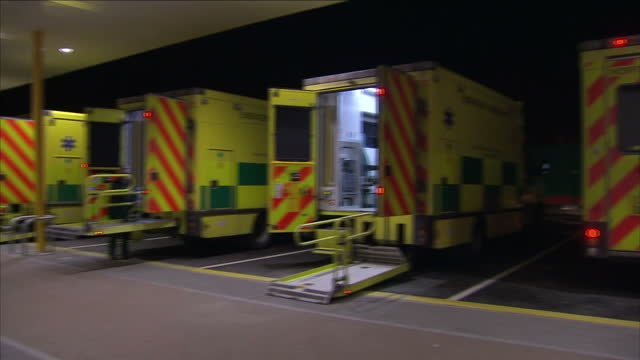 stock shots hospital exteriors ambulances lined up outside hospital - merseyside stock videos and b-roll footage