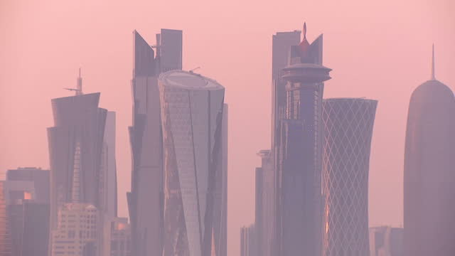 stock shots of a pink sunset doha skyline and boats on the water in harbour on july 2nd, 2017. - doha stock videos & royalty-free footage