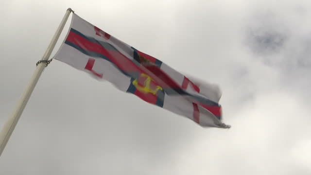 stock shots of seaside on cloudy murky day in westonsupermare on on 31st july 2017 includes shots of rnli flag waving in wind - weston super mare stock videos and b-roll footage