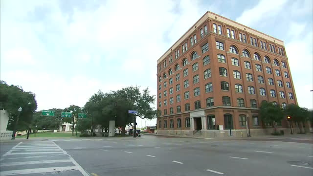 vídeos de stock e filmes b-roll de stock shots of the texas school book depository building on elm street in dallas texas where president john f kennedy was assassinated by lee harvey... - john f. kennedy