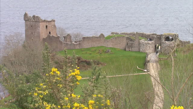 Stock shots of Urquhart Castle by the Loch as well as Loch Ness Includes shots of boats moored on Loch Ness at marina