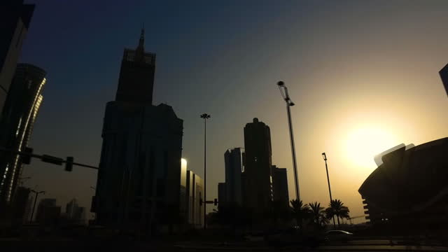 Stock shots point of view driving through city centre passing skyscrapers in Doha Qatar on July 2nd 2017