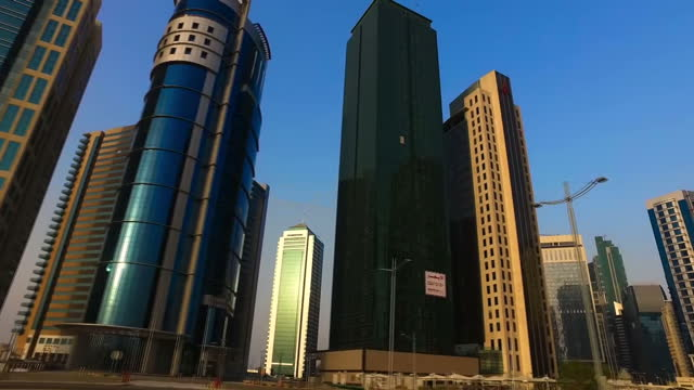 stock shots point of view driving through city centre, passing skyscrapers in doha, qatar on july 2nd, 2017. - doha stock videos & royalty-free footage