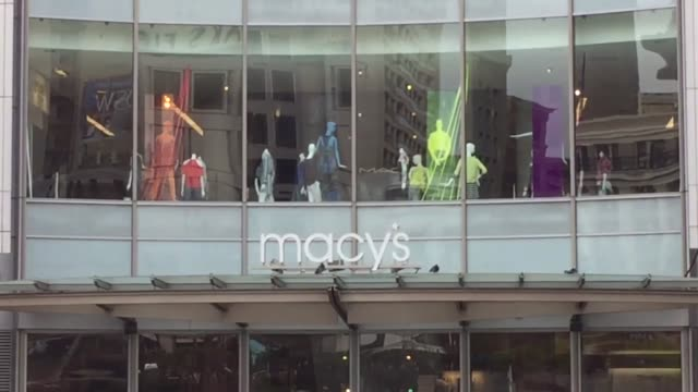 Stock spa res customers entering Union Square store Macy's signage Macy's