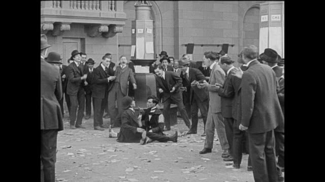 1920 stock trader (buster keaton) frantically buys stock with acrobatics along the way - buster keaton stock videos and b-roll footage