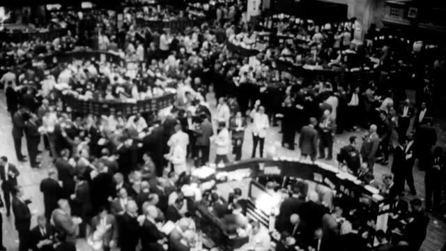/ stock traders working on the new york stock exchange floor / ha view of the trading floor stock trading on the nyse floor on may 31 1962 in new... - making money stock videos & royalty-free footage