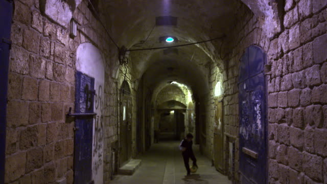 stock video footage of a boy playing soccer in an akko alley filmed in israel at 4k with red. - akko stock videos and b-roll footage