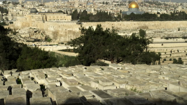 stock video footage of jewish cemetery and old jerusalem filmed in israel at 4k with red. - east jerusalem stock videos & royalty-free footage