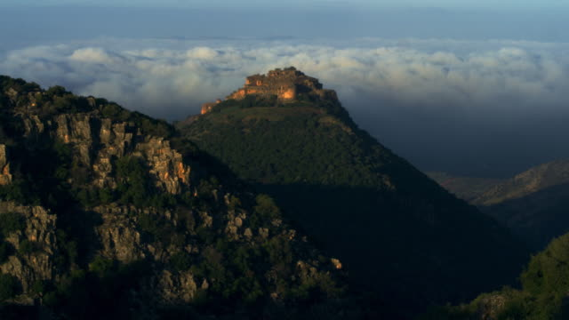 Stock Video Footage of Nimrod Fortress above a cloudy valley shot in Israel at 4k with Red.