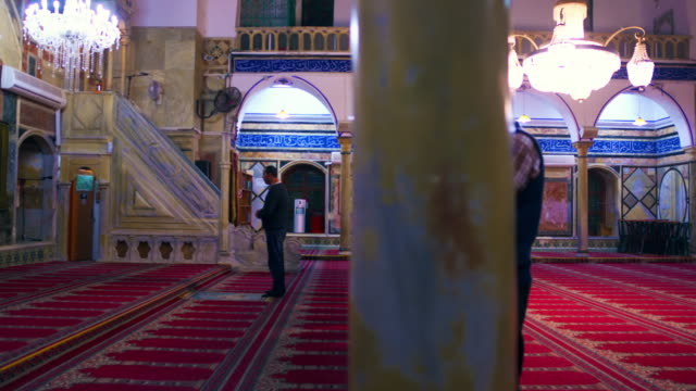 stock video footage of praying muslims at a mosque filmed in israel at 4k with red. - akko stock videos and b-roll footage