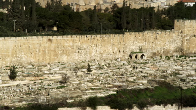 stock video footage of the muslim cemetery and golden gate of jerusalem filmed in israel at 4k with red. - gerusalemme video stock e b–roll