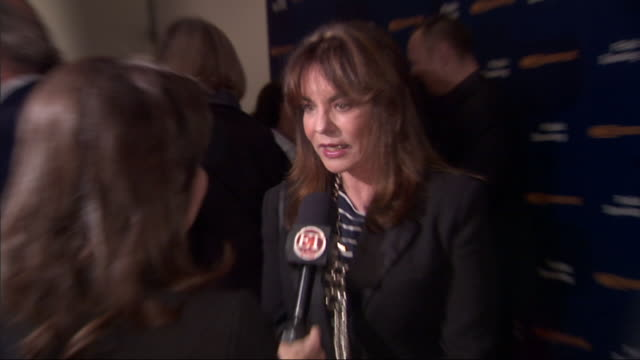 MCU Stockard Channing talking to reporter on the red carpet at MoMA