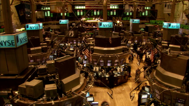 stockbrokers at the new york stock exchange walk among the computer terminals on the trading floor. available in hd. - new york stock exchange stock videos and b-roll footage
