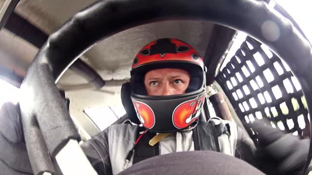 Stock-car driver turns steering-wheel full rotation (Steering-Wheel POV)
