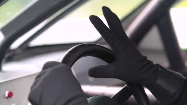 Stock-car driver's right hand grips steering wheel