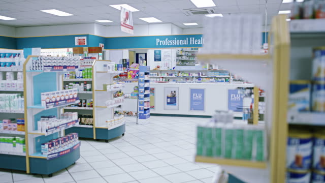 stocked with everything you need to be well - pharmacy stock videos & royalty-free footage