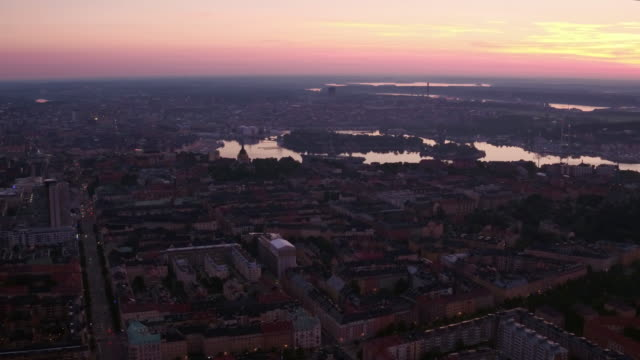 AERIAL: Stockholm city and a purple sunset.
