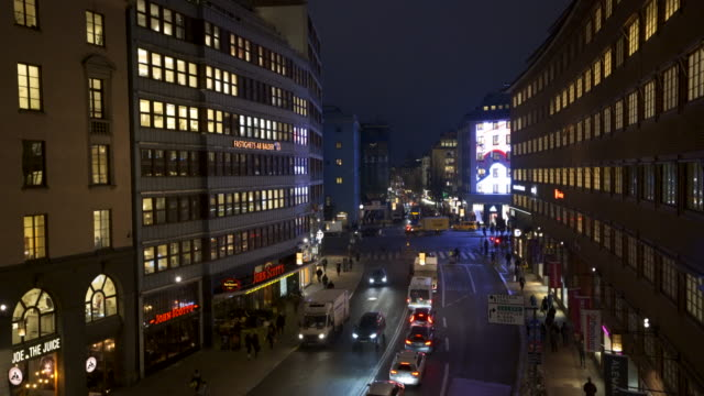 Stockholm night, evening scene, with people and traffic