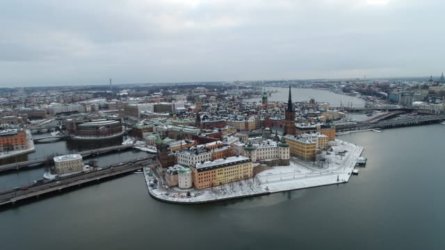 stockholm old town cover  with snow seen from sea drone view - sweden stock videos & royalty-free footage
