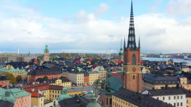 stockholm old town seen from sea, drone view - svezia video stock e b–roll