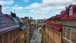 Stockholm street, taking off showing rooftops