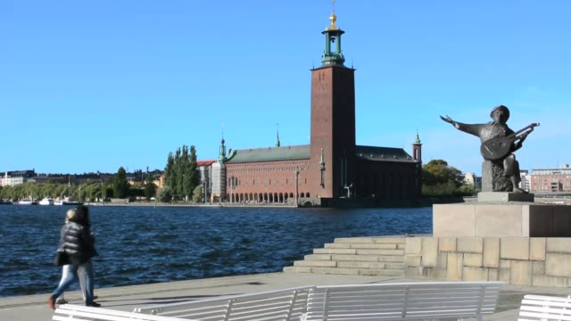 Stockholm Sweden downtown City Hall and Music statue near water in city Stadshuset at Lake Malaren 1907 Evert Taube